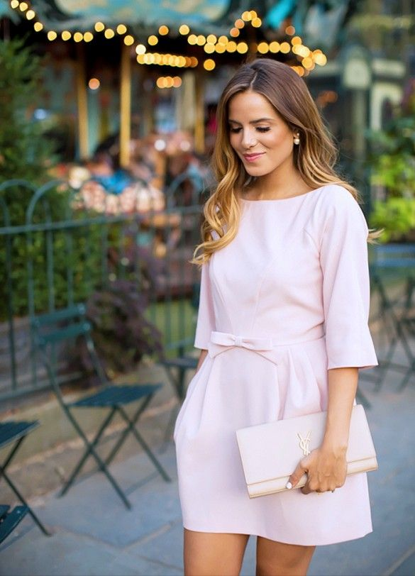 Girly look with pink mini dress, pearls, and YSL clutch.: