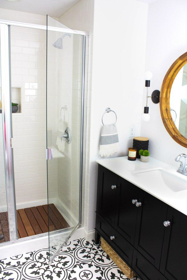 Subway Tile Shower with Chrome Accents and Teak Shower Mat