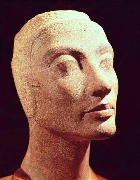 Unfinished quartzite head of Nefertiti,wife of Akhenaten. Height: 35.5 cms.Amarna Style c.1353-36 B.C. •Egyptian Museum,Cairo•