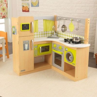 Made for the ultimate chef in your home, our KidKraft Limited Edition Natural Lime Corner Kitchen is a little chef's dream come true! Realistic interactive features bring the imaginative environment to life with appliance doors that open and close, realistic burners and clicking, turning knobs. Age Range: 3+ #cocinaspequeñascerradas