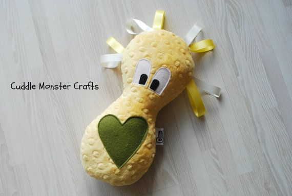 Cuddle Monsters are super soft sensory toys for babies, and make wonderful comforters for children of any age. Made from luxurious textured plush material, their monster bodies feel lovely, and are designed to be the perfect shape for squeezes with your own little monster. All of my monsters have ribbon hair do's, made from silky satin ribbons, which young children love to feel and play with. Playing with the ribbons also provides great comfort, and sensory stimulation that babies adore
