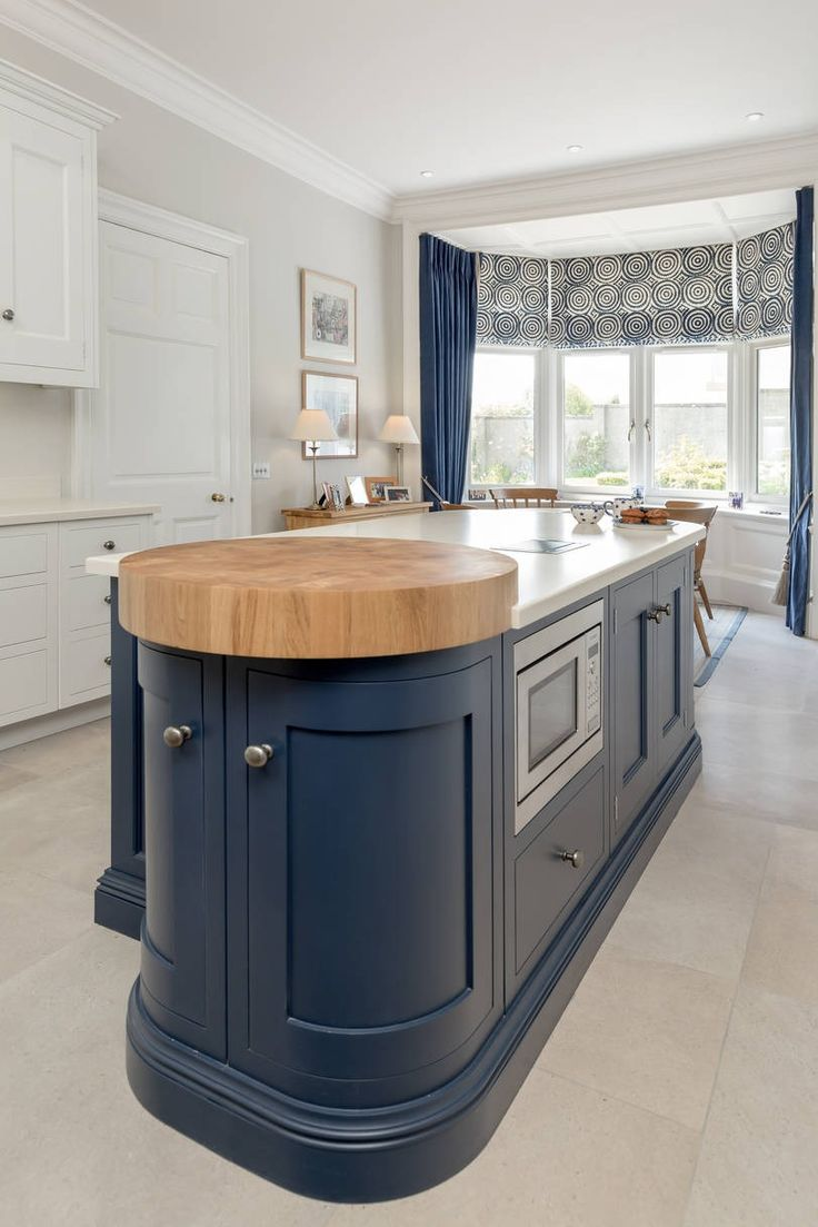 Double curve on a kitchen Island with Oak chopping block ...