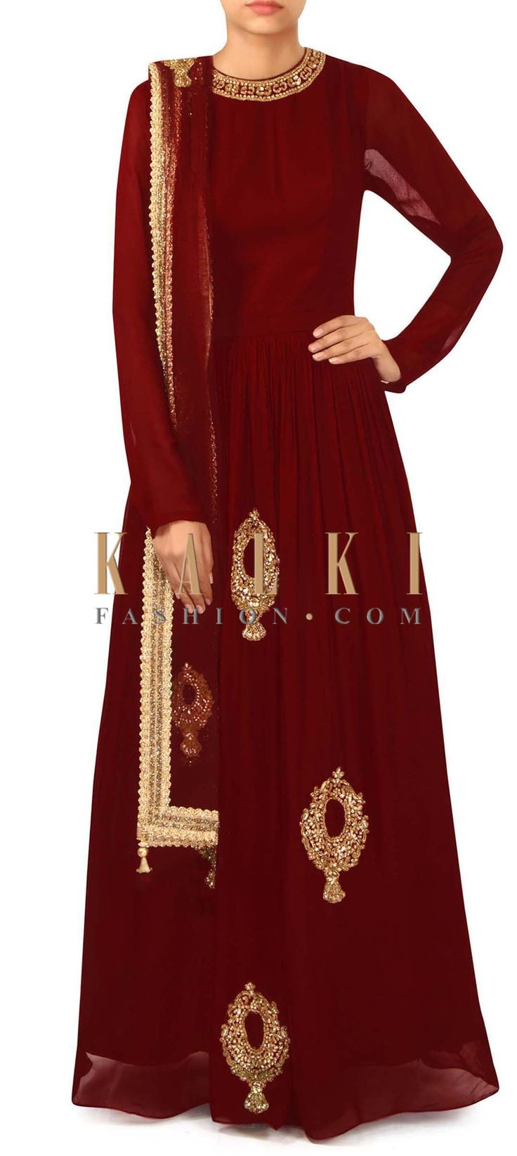 Red suit in embroidered neckline and butti only on Kalki