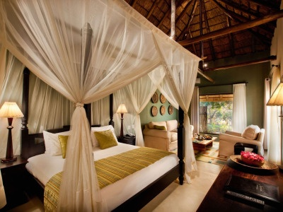 Safari bedroom - mine is close - need curtains and softer linens