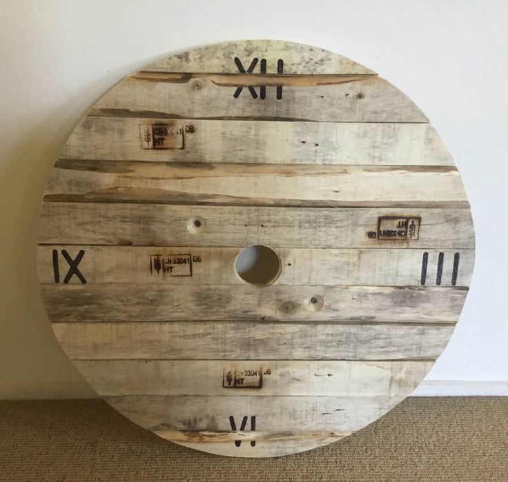 Fake cable reel clock face made from pallet wood.