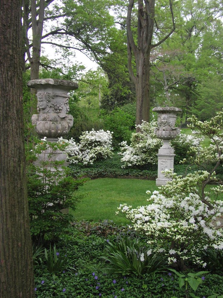 White garden. Urns in the Bald Cypress Allee at the Marian Coffin Garden at Gibraltar in Wilmington, Delaware. Beautiful backyards