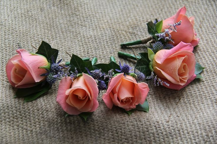 Coral buttonholes http://wanakaweddingflowers.co.nz/gallery/buttonholes-corsages/