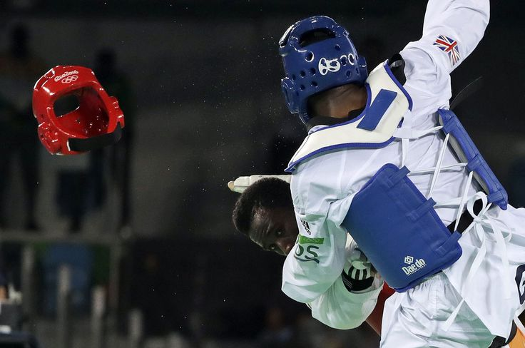 Lutalo Muhammad of Great Britain, right, and Cheick Sallah Junior Cisse of Ivory…