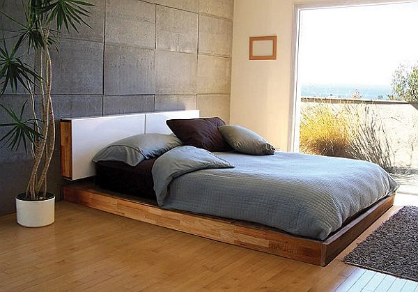 diy platform bed with AWESOME rock material wall behind. i will have this in my home....