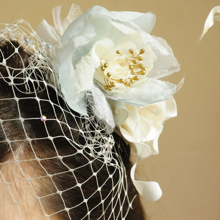 Hand-curled silk rose with gold accents