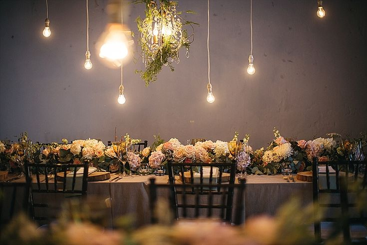 Hawksmoor house with bare lightbulbs and floral details