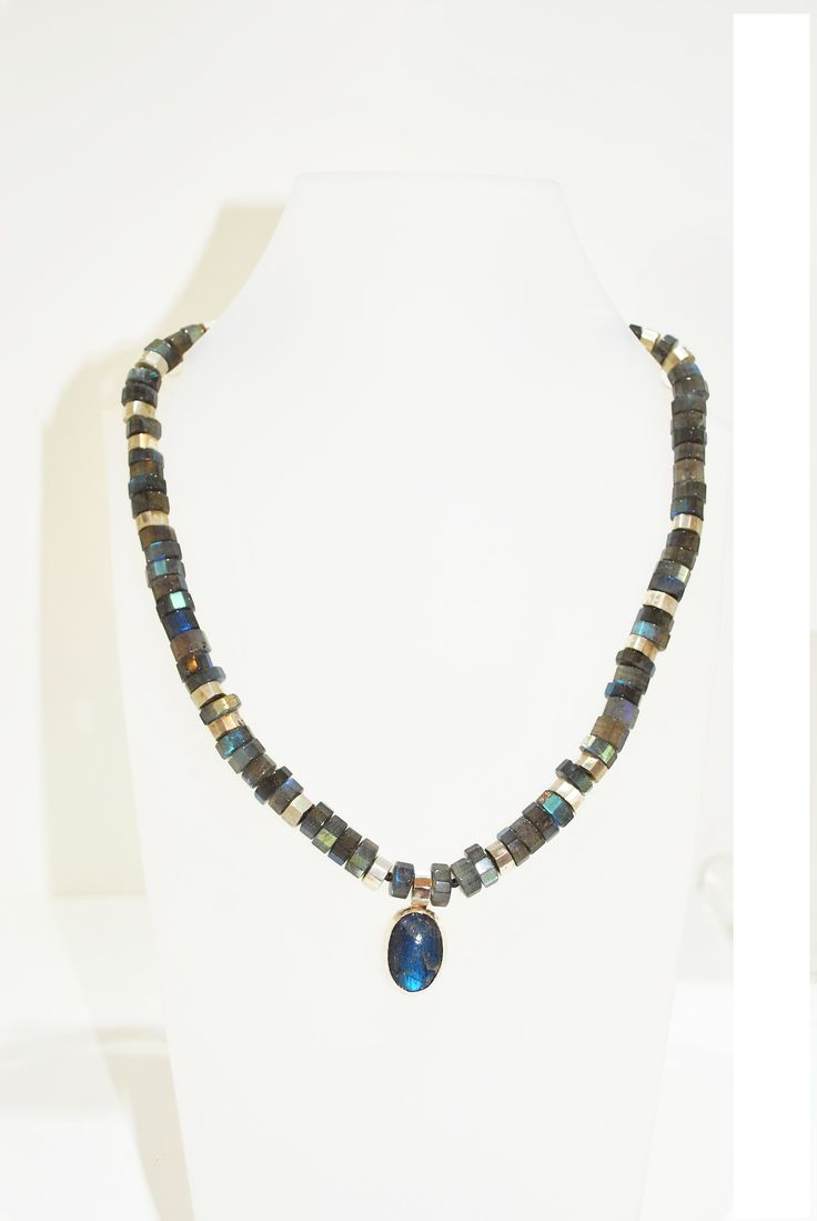 This necklace features round faceted beads of sterling silver and Labradorite.