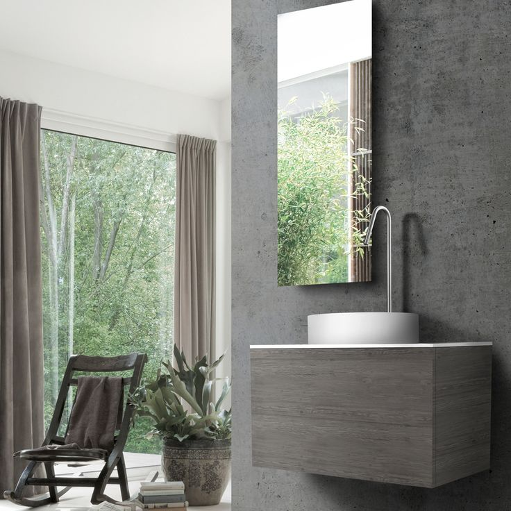 Textured concrete walls and greenery combine to provide a fresh, modern aesthetic. Wall-mount vanity from new 51 collection features exceptionally durable HST finish, blu•stone™ vessel sink and countertop paired with INOX stainless steel faucet. #fresh #haven