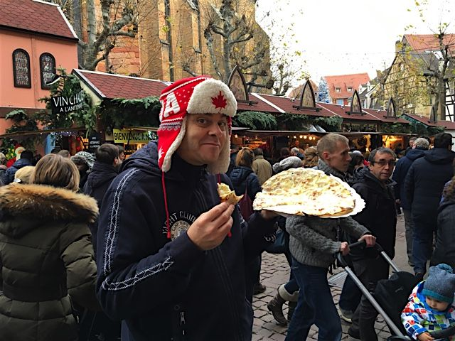 Eating a tarte Flambee on the Xmas market in Colmar