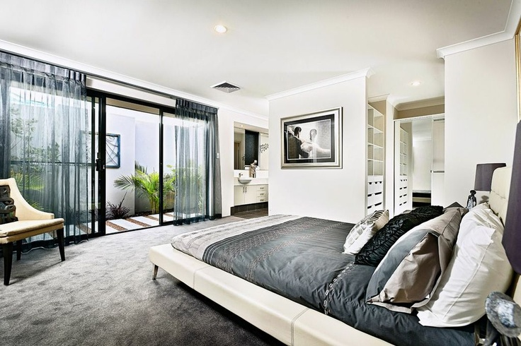 Master bedroom with ensuite bathroom and terrace view.