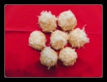 Italian Snowballs (palla di neve).  These traditional classic Italian cookies have an anise-flavored frosting and they are then coated in coconut.