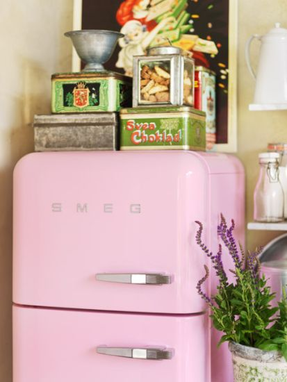 A colorful Smeg Fridge begs for a colorful display above and around!