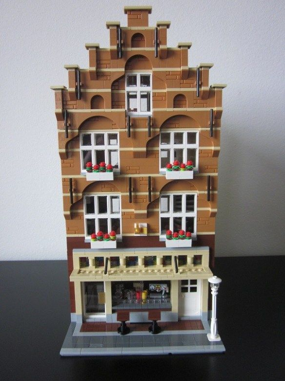 Man with a Hat has created a stunning Amsterdam-style building with a shop downstairs and a fully furnished apartment upstairs.