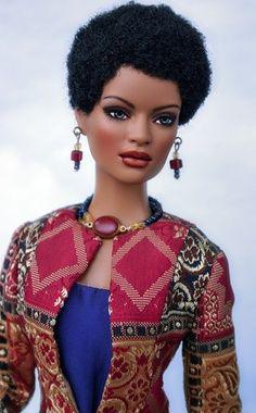 Afro Barbie- http://www.quickbuysonline.com/black-doll-or-white-doll/