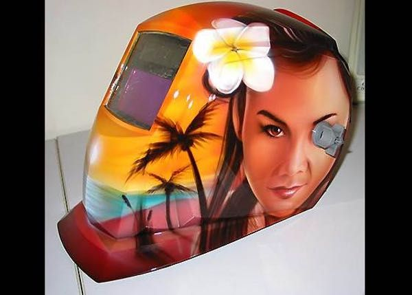 Hawaiian Babe On the Hood is listed (or ranked) 4 on the list Rank the Coolest Custom Welding Helmets!
