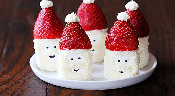 SANTA HAT MARSHMALLOWS – how cute are these? All you need are marshmallows, frosting and strawberries! And head to your local baking supply place and pick up an edible marker – no, you don't eat the marker, it's filled with food-grade dye to  give Santa a face!