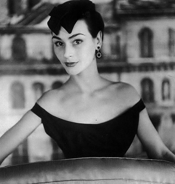 "1953 - Anne Gunning wearing Dior's popular double ""Widow's Peak"" hat in black velvet & grosgrain."