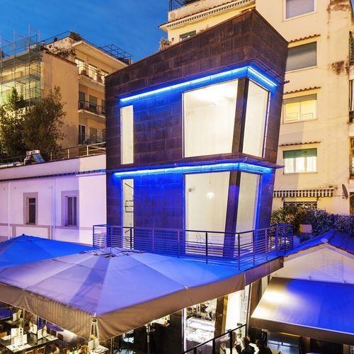 """Il ristorante """"Macello"""" situato nella zona di Ponte Milvio, sulla antica Via Flaminia, è stato realizzato con un ampliamento di un nuovo volume architettonico a forma di """"Torretta"""". L'intervento"""