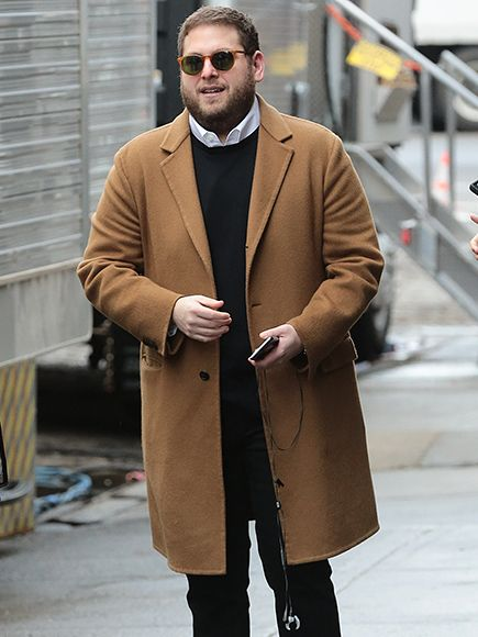 From his chic amber brown jacket to his vintage-inspired round sunnies, Jonah Hill couldn't have looked more dapper!