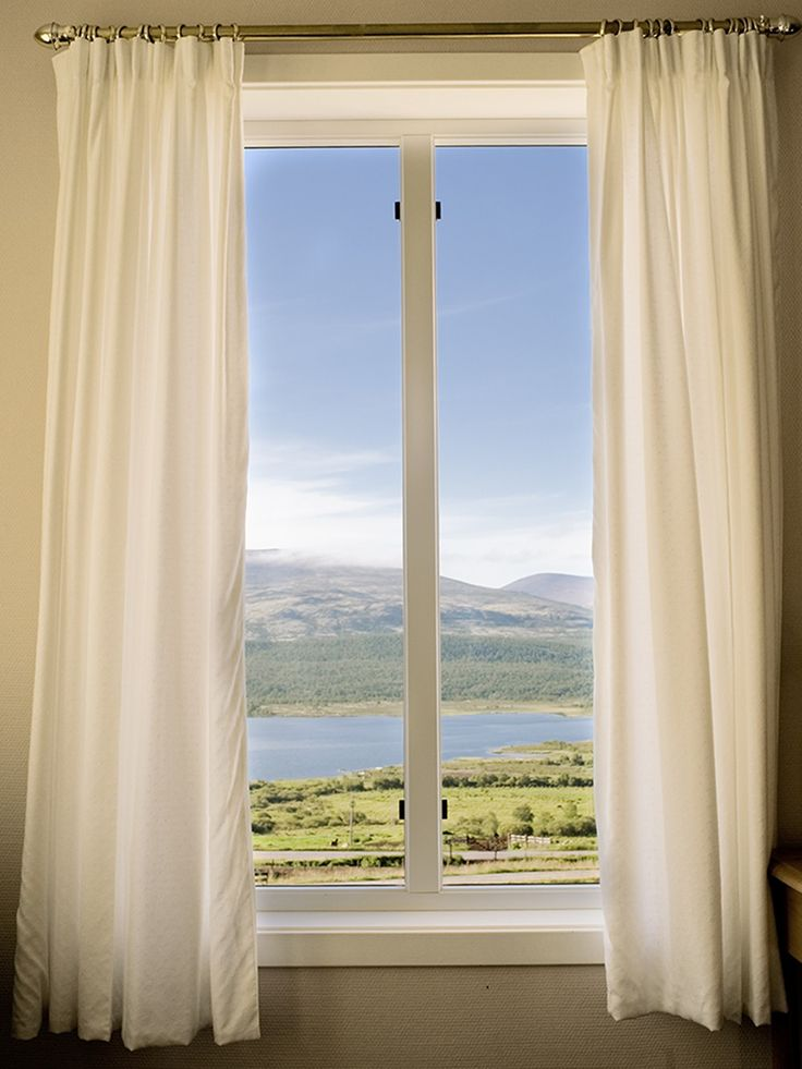 """""""It seems a paradise in their imagination"""" by Anna Sundström. #photography #art #window #view #ocean #lake #curtains #forest #trees  Available at: http://www.arrivals.se/product/it-seems-a-paradise-in-their-imagination-by-anna-sundstrom"""