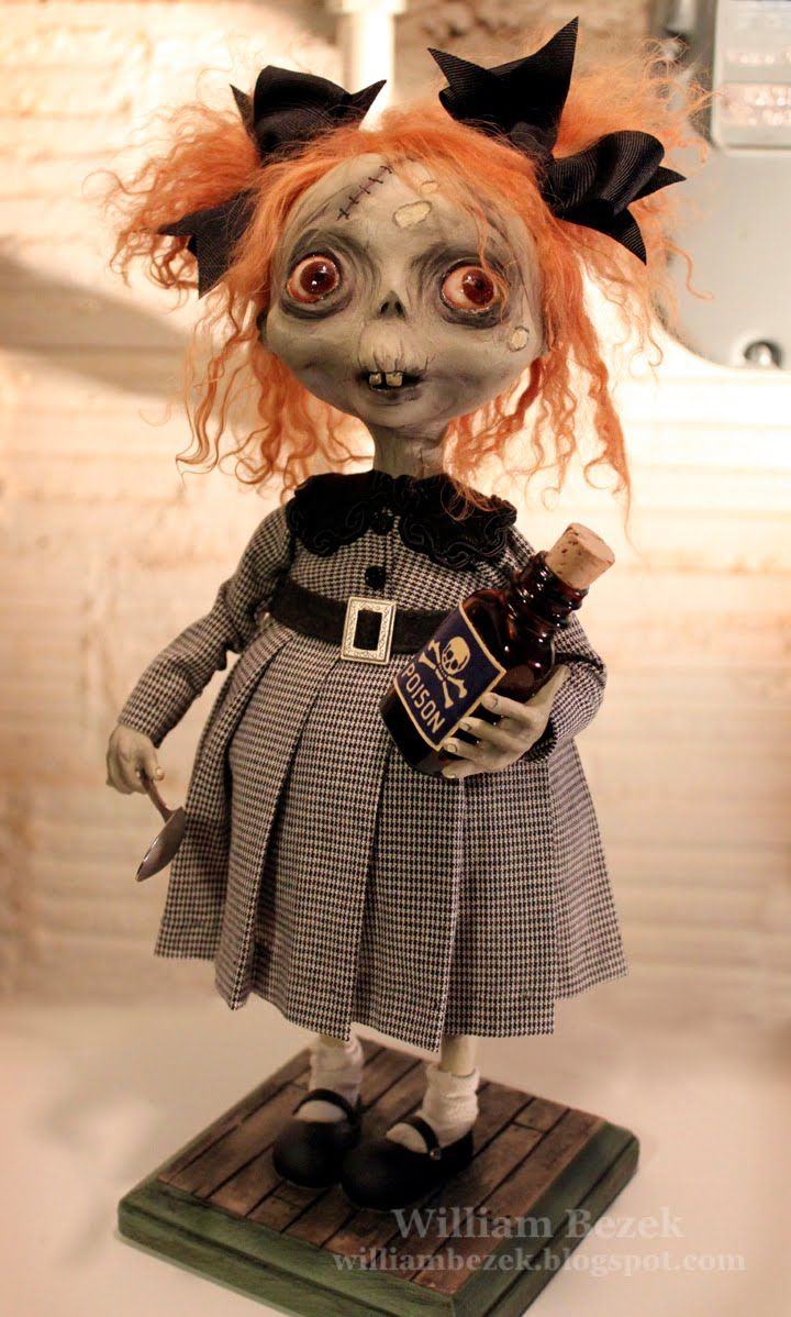 Little Zombie Girl -This one of a kind, 15 inch sculpture is made from epoxy and paperclay and is mounted to a carved base. She has glass taxidermy eyes and a lambskin wig. She carries a real silver spoon and an antique bottle.