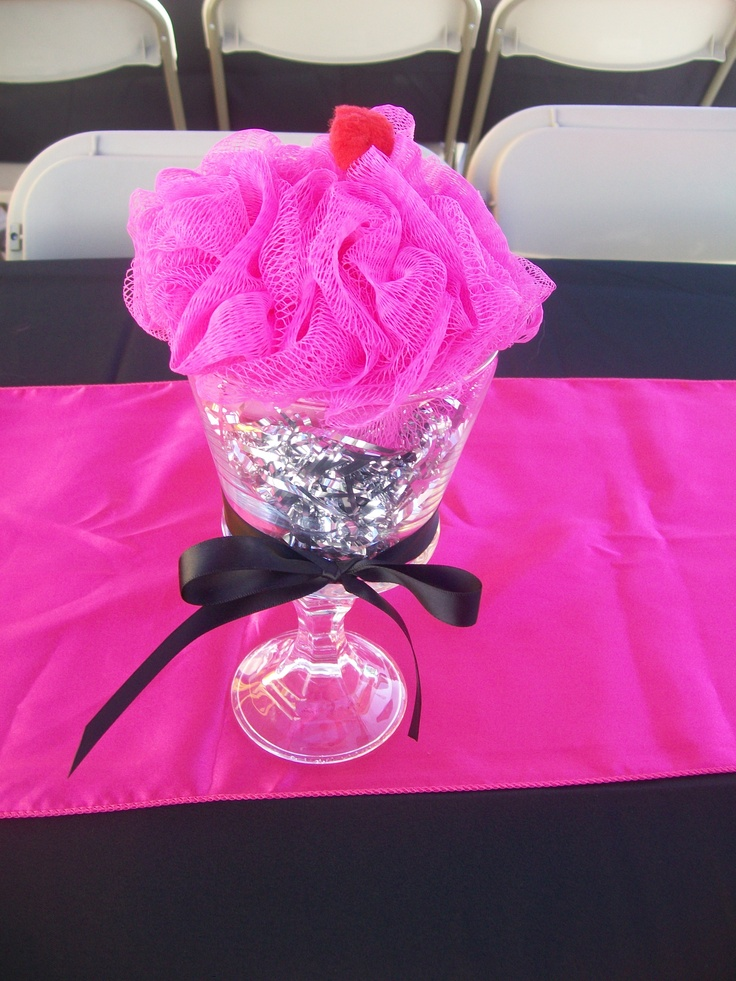 DIY Cupcake centerpiece made by me!  Candle stick and glass container each from the dollar store are glued using glass cement.  Used a hot pink loofah for the frosting, a red pom pom for the cherry, silver tinsel as a filler and a black ribbon to tie in her colors.  Grand total...$3.50
