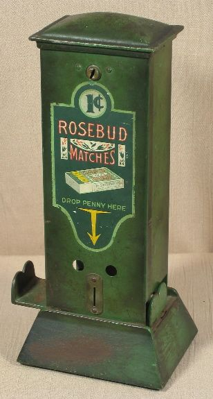 "Northwestern Ohio Blue Tip Match Vendor. Northwestern Corporation, Morris, IL, c. 1925, 13"". Cast iron base and lid and a sheet metal body. Vending machine. Small Vintage Vending"