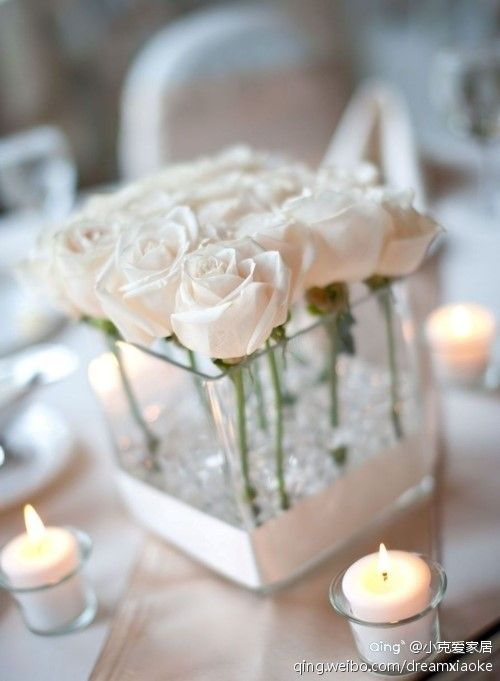 White Roses for a white wedding theme. Candles complimenting the soft petals. Facebook: https://www.facebook.com/media/set/?set=a.10151388376035546.524493.42866320545=3 Twitter https://twitter.com/CamdenWeddings
