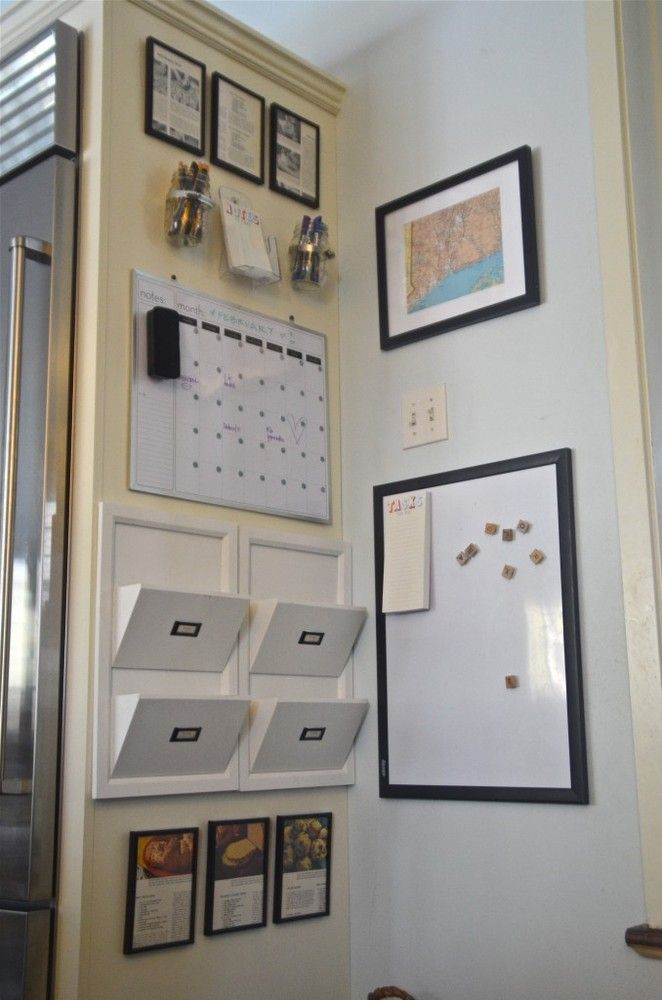 Clear off your countertops with this DIY Kitchen Command Center. Grab a calendar, mail slots, and dry erase board for the most organized kitchen corner ever!