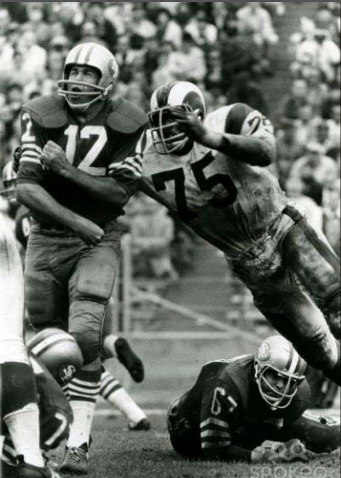 c01b82a3138 QB John Brodie of the 49ers under heavy pressure from Deacon Jones of the  Rams.