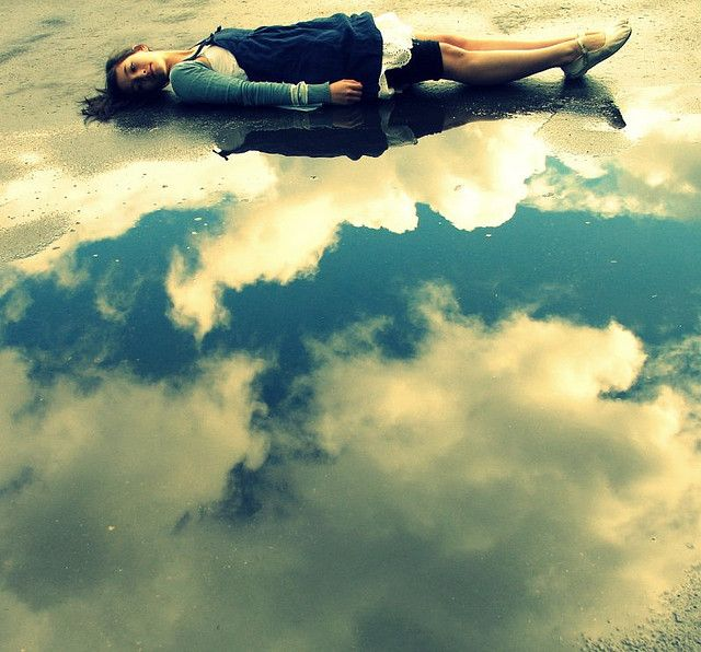 by nikki.jane on flickr - she lay down at the edge of puddle made of sky and rolled in