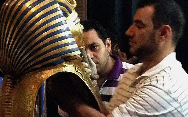 Cairo Museum Jan'2015: The moment a staff glues the beard part of King Tutankhamen's golden mask with epoxy