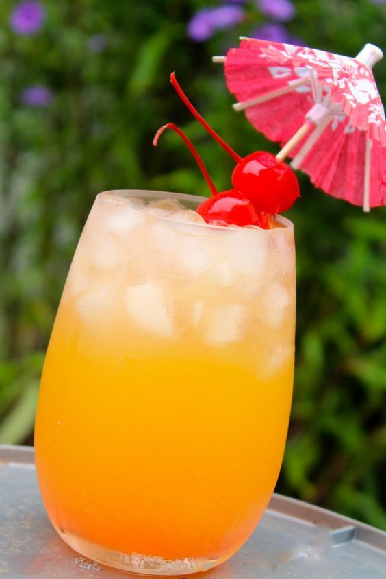 Mangolicious: Malibu Coconut Rum, Mango Juice, Pineapple Juice, Watermelon Pucker, Maraschino Cherry.