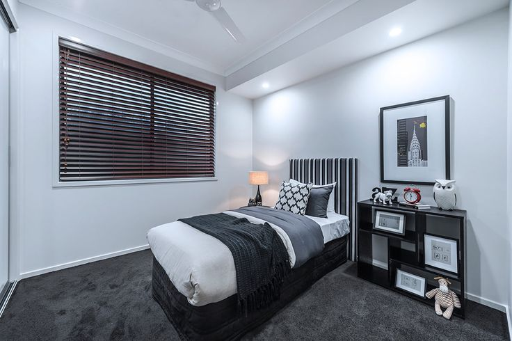#Bedroom #interior #design #inspiration from #Ausbuild's Allendale display home. This #bedroom features soft grey carpet combined with crisp white walls and a striped #bed head