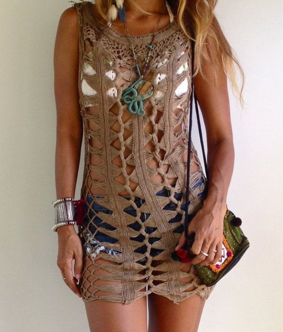 Beautiful Brown Crochet Dress. Great for the beach, festival, summer wear. Stretchable Cotton Very soft and comfortable  Care: Hand or Machine Wash  Measurements: Bust:32 stretches to 49 Hip: 35 stretches to 50 Length: 30  Please let me know if you have any questions