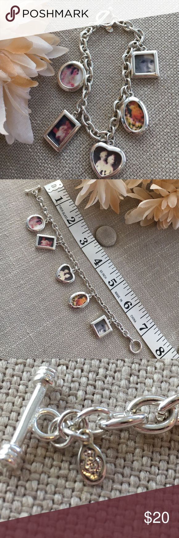 Vintage Silver Pictures Charm Bracelet This lovely Vintage Pictures Charm Bracelet is silver tone and includes space on charms for you personalize with 5 photos. Not sure if the brand but I took a photo of the tag with the stamp, also not sure of the metal although it's on the heavier side. Bracelet was my Mom's, she's had it for years, received it as a gift and never wore it. Offers welcome! Photos easily slide in back, see pic. Vintage Jewelry Bracelets