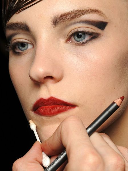 from Armani S/S '13, but I like the graphic cut crease/cat eye conglomeration