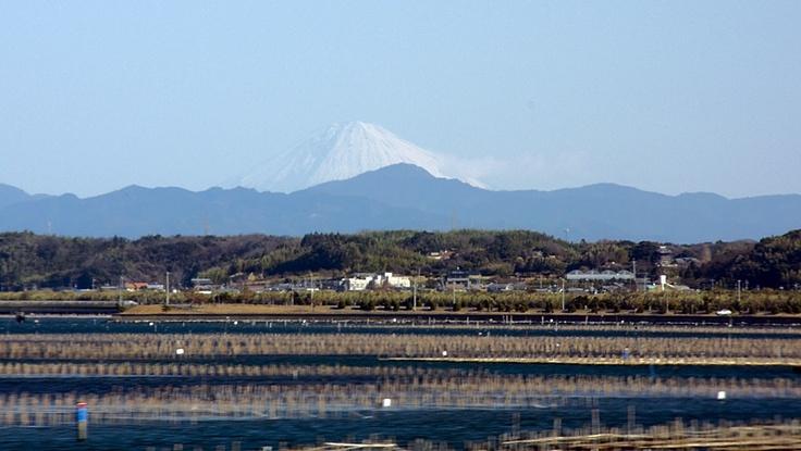 View of Mount Fuji across Lake Hamana. Photographed from a moving train on the Tōkaidō Shinkansen.