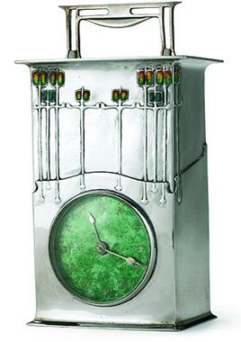 The 'Magnus' a silver and enamel clock designed by Archibald Knox for Liberty & Co