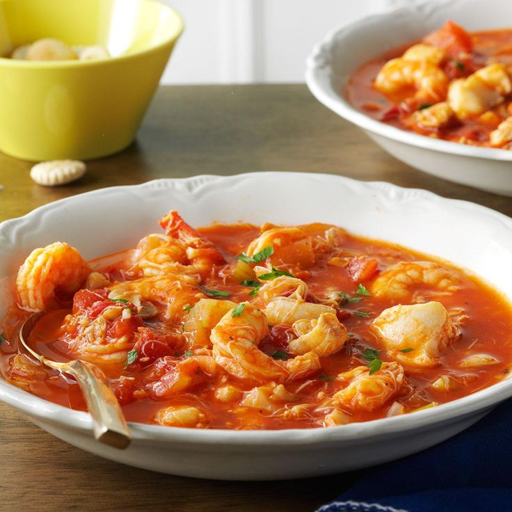 Seafood Cioppino Recipe -If you're looking for a great seafood recipe for your slow cooker, this classic fish stew is just the ticket. It's brimming with clams, crab, fish and shrimp, and is fancy enough to be an elegant meal. —Lisa Moriarty, Wilton, New Hampshire
