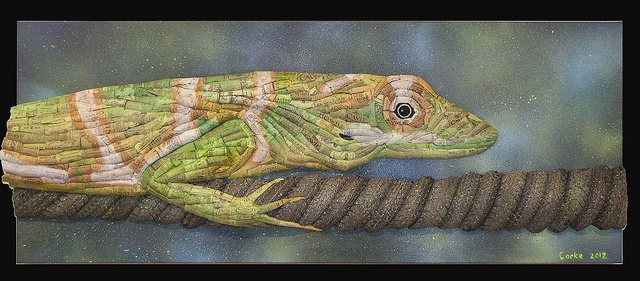 """""""The New Lizard in Town""""  16"""" x 40""""  recycled bike tires, recycled newspaper, recycled wine corks, spray paint, acrylic, glue, and foam on canvas        #recycling #recycle #art #AndrewCorkeArt #NewAgeArt #Nature #Lizard #Anole #tire #tires #biketires #Wine #Winecorks #corks  #Life #KnightAnole #Mixedmedia #3D #Recycledmaterial #Fineart #Awesome #Epic     All images © AndrewCorkeArt   www.AndrewCorke.Com"""