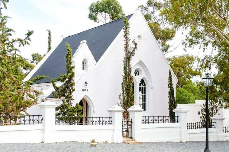 Karoo inspired wedding at Matjiesfontein, with touches of Zimbabwe.Proteas, fynbos, roses, flamelilies, blushing brides, succulents, night sky. Old church Event planner | Wedding planner | Florist | Floral designer | Cape Town