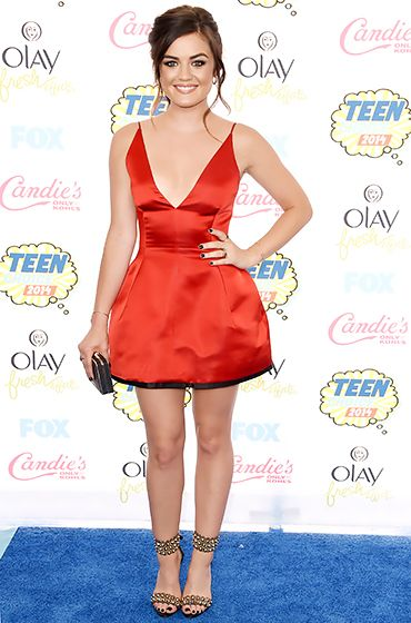 Lucy Hale looked gorgeous in a red satin Dior dress with a plunging neckline and gold-studded Brian Atwood heels at the 2014 Teen Choice Awards