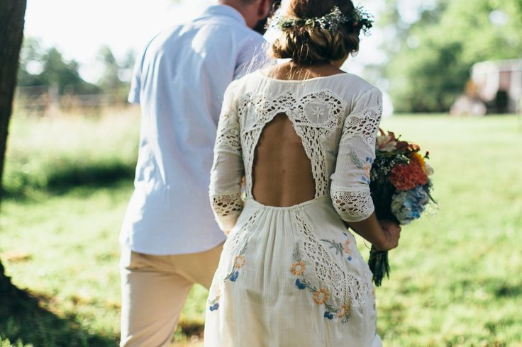 Handmade lacey, embroidered wedding dress! Looks boho and vintage! Love it!!! Plus the floweres in her hair.