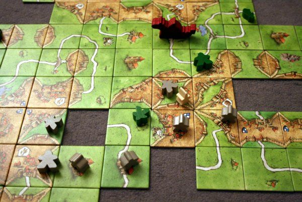 Carcassonne, a tile-based strategy board game for 2 to 5 players. (Robertson, 2009)